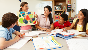 Students and teacher in group working - 350x200.png